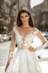Wedding dresses Anastace Collection  City Passion  Silhouette  A Line  Color  Blush  Ivory  Neckline  Portrait (V-neck)  Illusion  Sleeves  Long Sleeves  Fitted  Train  With train - foto 3
