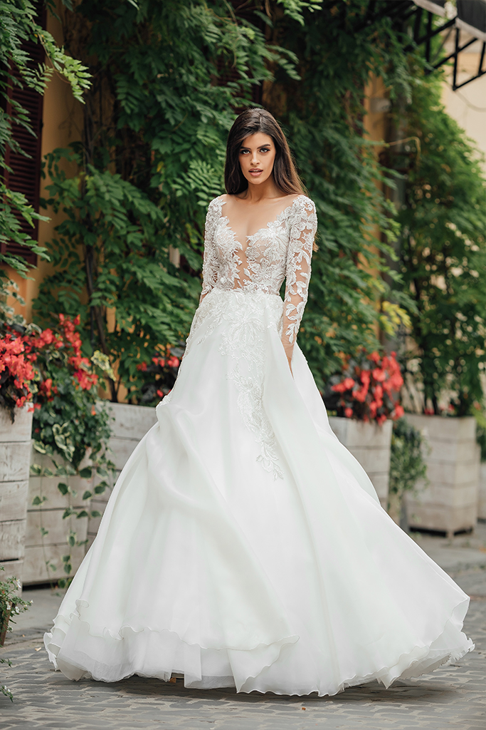 Wedding dresses Emma Collection  City Passion  Silhouette  A Line  Color  Blush  Ivory  Neckline  Portrait (V-neck)  Illusion  Sleeves  Long Sleeves  Fitted  Train  With train - foto 4