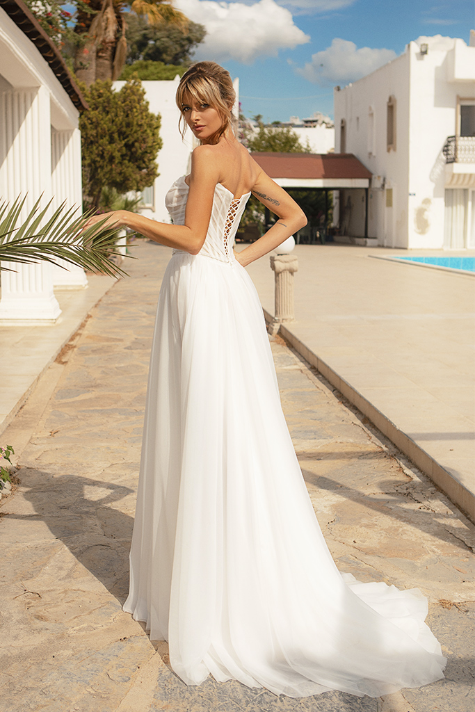 Wedding dresses Susan Silhouette  A Line  Color  Ivory  Neckline  Straight  Sleeves  Sleeveless  Train  With train - foto 2