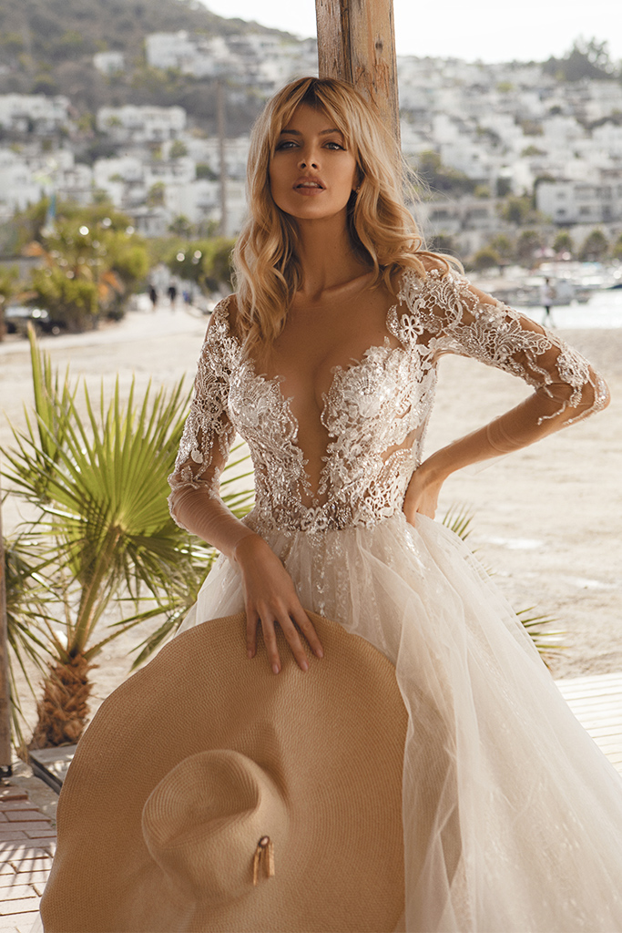 Wedding dresses Tayana Silhouette  A Line  Color  Blush  Neckline  Portrait (V-neck)  Sleeves  Long Sleeves  Train  With train - foto 2