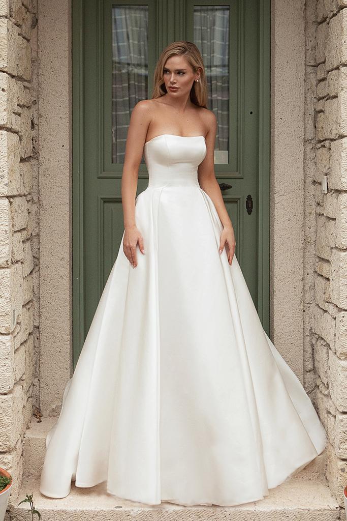 Wedding dresses Tesora Silhouette  A Line  Color  Ivory  Neckline  Straight  Sleeves  Sleeveless  Train  With train - foto 3