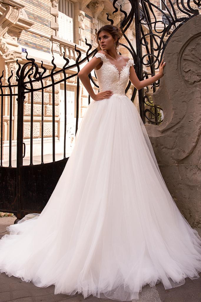 Wedding dress Mylie Silhouette  A Line  Color  Ivory  Neckline  Portrait (V-neck)  Sleeves  Sleeveless  Train  With train - foto 3