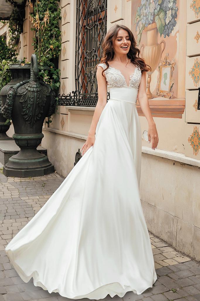 Wedding dress Bernadette Silhouette  A Line  Color  Ivory  Neckline  Portrait (V-neck)  Sleeves  Sleeveless  Train  With train - foto 3