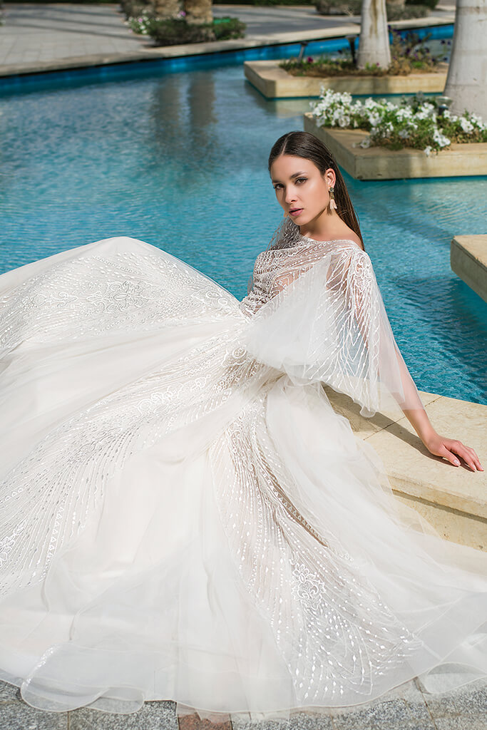 Wedding dresses Eos Collection  Fresh Touch  Silhouette  A Line  Color  Ivory  Neckline  Bateau (Boat Neck)  Sleeves  Detachable  Wide straps  Train  With train - foto 6