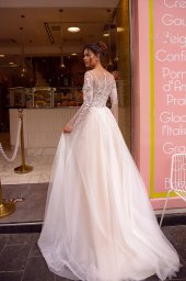 Wedding dresses Fibi Collection  Côte d'Azur  Silhouette  A Line  Color  Blush  Ivory  Neckline  Jewel  Sleeves  Long Sleeves  Fitted  Train  With train - foto 3