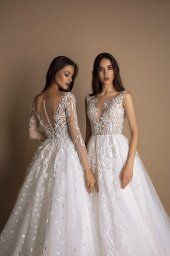 Wedding dresses Indila Collection  New Look  Silhouette  A Line  Color  Ivory  Neckline  Portrait (V-neck)  Illusion  Sleeves  Long Sleeves  Fitted  Train  With train - foto 4