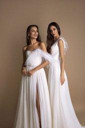 Suknie ślubne Coco Kolekcja  New Look  Sylwetka  Balowa suknia   Kolor  Kremowy  Dekolt  Dekolt w kształcie serca  Rękawy  Ramiączka spaghetti  Flex  Z trenem - foto 3