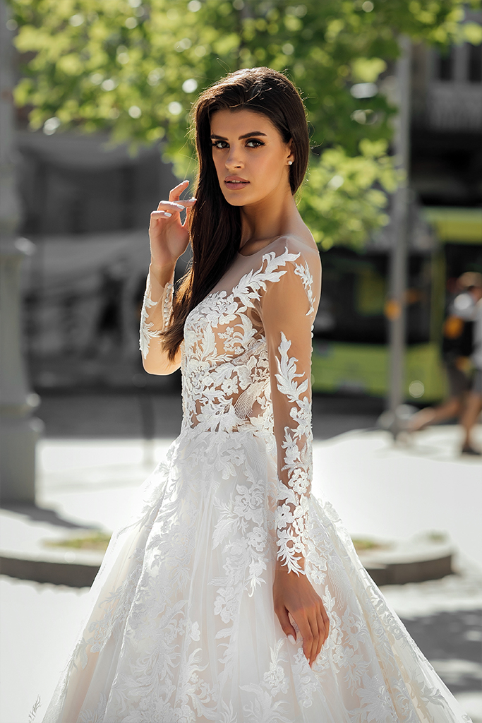 Wedding dresses Anastace Collection  City Passion  Silhouette  A Line  Color  Blush  Ivory  Neckline  Portrait (V-neck)  Illusion  Sleeves  Long Sleeves  Fitted  Train  With train - foto 4