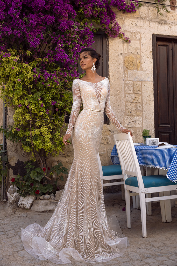 Wedding dresses Asteria Collection  Highlighted Glamour  Silhouette  Fitted  Color  Silver  Ivory  Neckline  Scoop  Portrait (V-neck)  Sleeves  Long Sleeves  Fitted  Train  With train