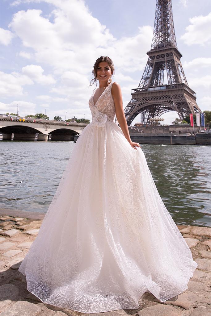 Wedding dresses Odri Collection  L`arome de Paris  Silhouette  A Line  Color  Ivory  Neckline  Portrait (V-neck)  Sleeves  Wide straps  Train  With train