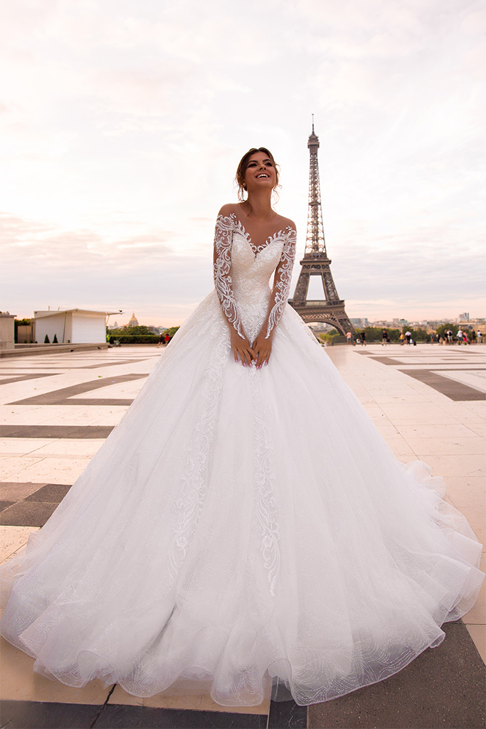 Wedding dresses Regina Collection  L`arome de Paris  Silhouette  A Line  Color  Ivory  Neckline  Sweetheart  Sleeves  Off the Shoulder Sleeves  Long Sleeves  Fitted  Train  With train