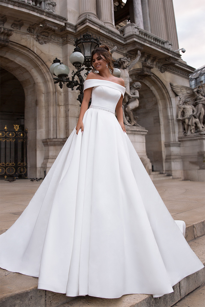 Wedding dresses Evis-1 Collection  L`arome de Paris  Silhouette  A Line  Color  Ivory  Neckline  Straight  Sleeves  Wide straps  Off the Shoulder Sleeves  Train  With train