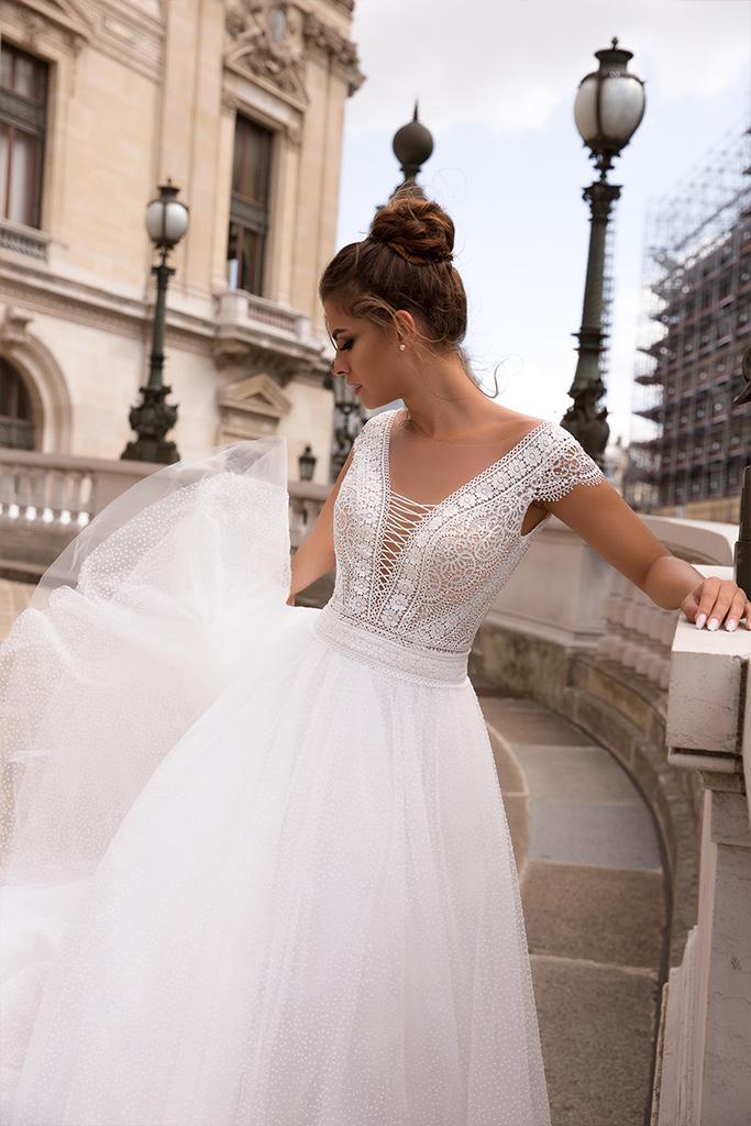 Wedding dresses Brooklyn Collection  L`arome de Paris  Silhouette  A Line  Color  Ivory  Neckline  Portrait (V-neck)  Sleeves  Wide straps  Train  With train