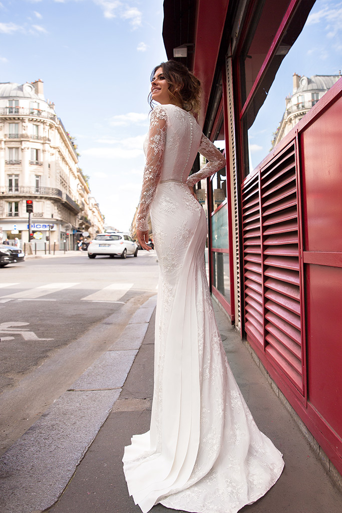 Wedding dresses Sabina Collection  L`arome de Paris  Silhouette  Fitted  Color  Ivory  Neckline  Portrait (V-neck)  Sleeves  Long Sleeves  Fitted  Train  With train