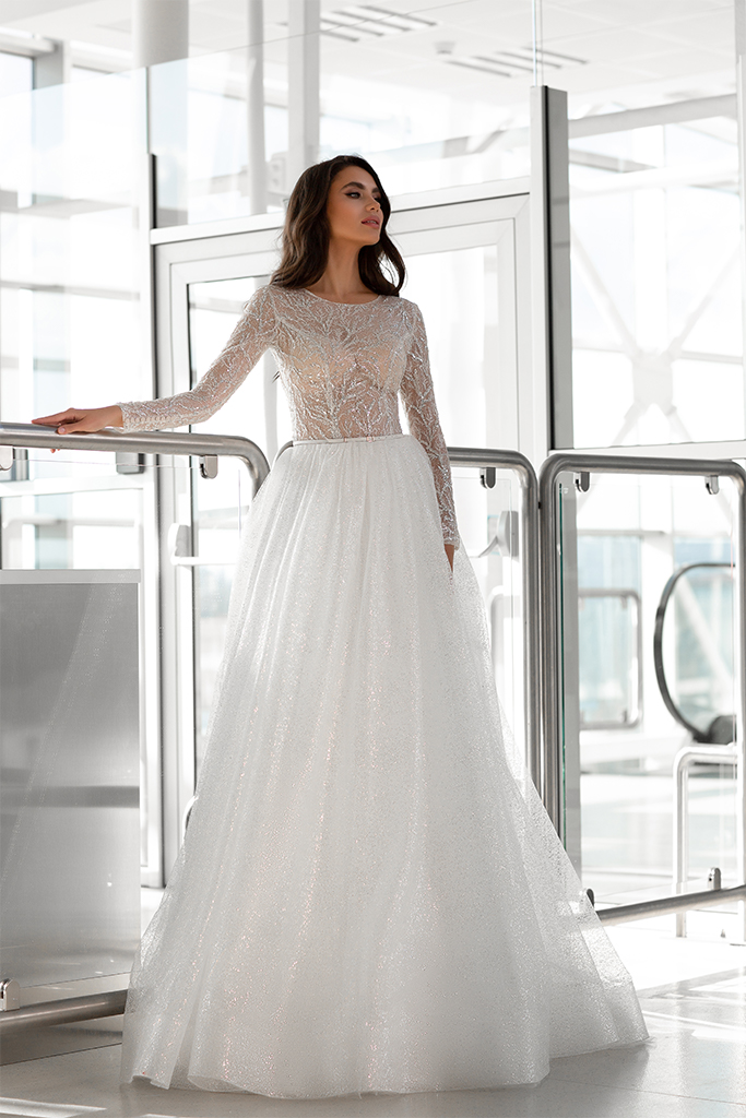 Wedding dresses Lirene Collection  Gloss  Silhouette  A Line  Color  Ivory  Neckline  Bateau (Boat Neck)  Sleeves  Long Sleeves  Fitted  Train  With train