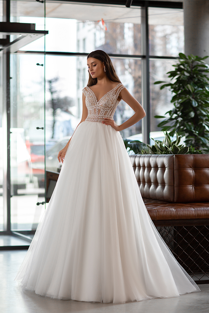 Wedding dresses Joanna Collection  Gloss  Silhouette  A Line  Color  Ivory  Neckline  Portrait (V-neck)  Sleeves  Wide straps  Train  With train