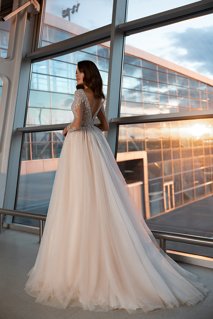 Wedding dresses Monreal Collection  Gloss  Silhouette  Ball Gown  Color  Ivory  Neckline  Portrait (V-neck)  Sleeves  Long Sleeves  Fitted  Train  With train