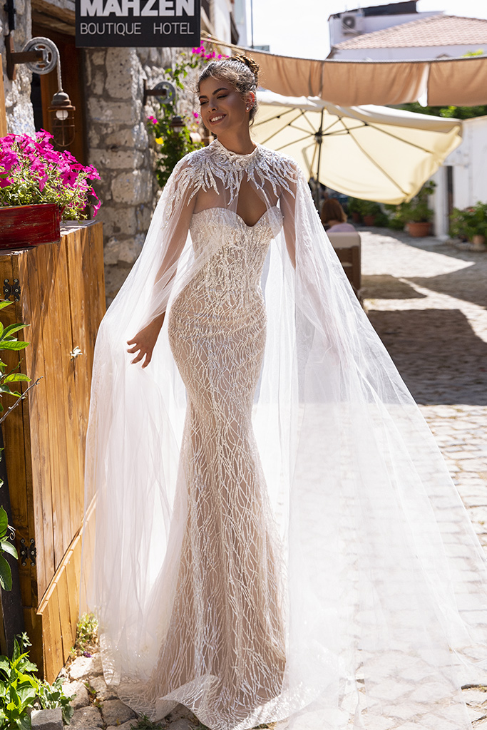 Wedding dresses Escada Collection  Highlighted Glamour  Silhouette  Fitted  Color  Silver  Ivory  Neckline  Sweetheart  Sleeves  Sleeveless  Train  Cape