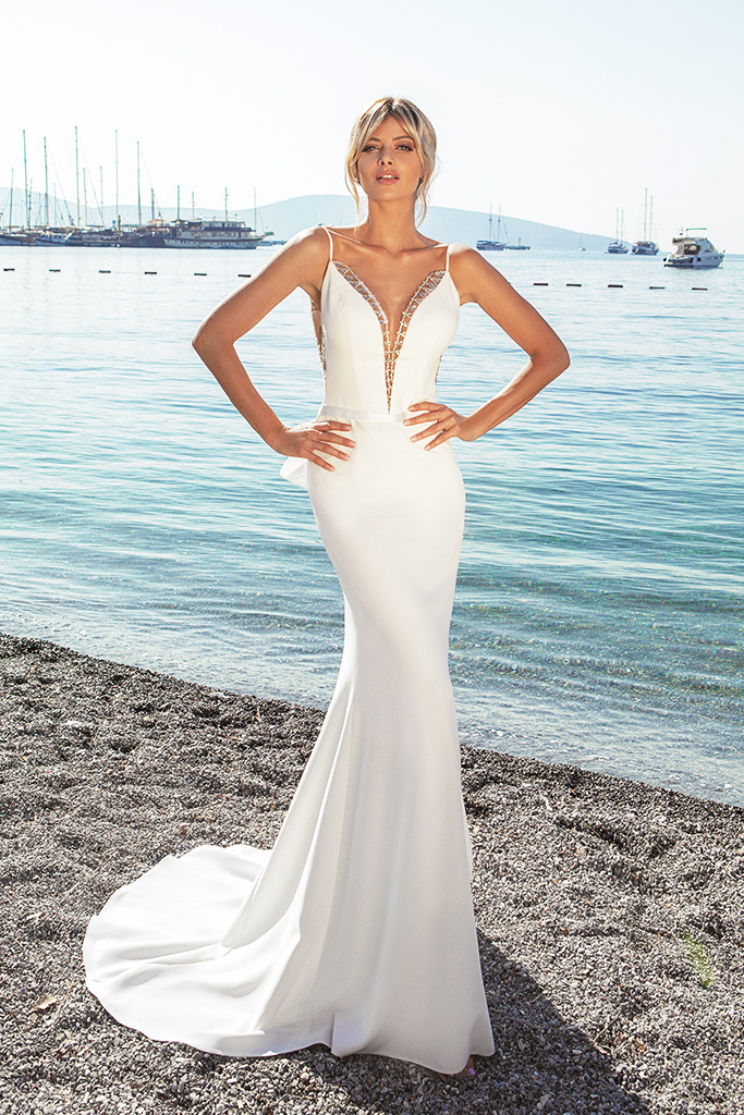 Wedding dresses Tina Silhouette  Fitted  Color  Ivory  Neckline  Portrait (V-neck)  Sleeves  Spaghetti Straps  Train  With train