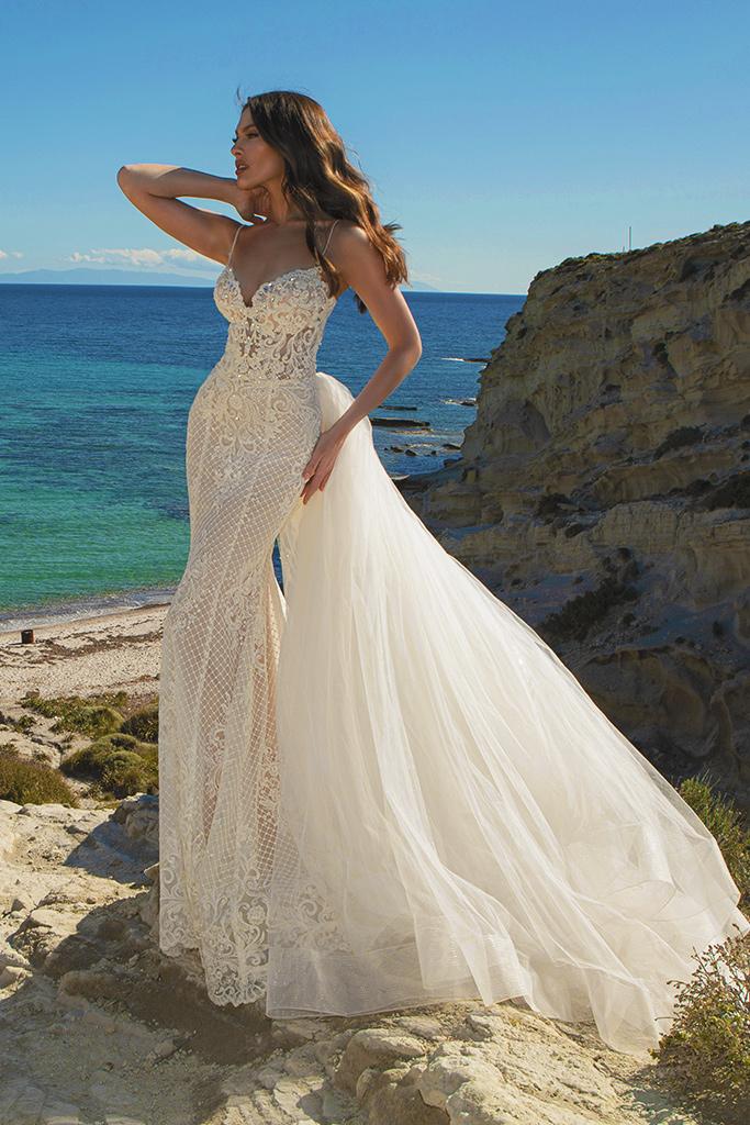 Wedding dresses Iman Silhouette  Fitted  Color  Ivory  Neckline  Straps  Train  Detachable train