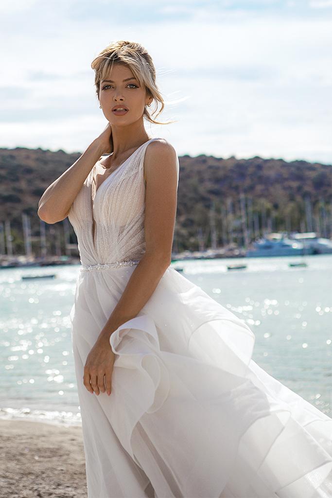 Wedding dresses Serena Silhouette  A Line  Color  Ivory-blush  Neckline  Portrait (V-neck)  Sleeves  Wide straps  Train  With train