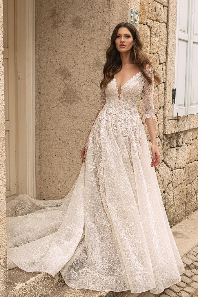 Wedding dresses Bruna Silhouette  A Line  Color  Ivory-blush  Neckline  Portrait (V-neck)  Sleeves  Long Sleeves  Train  With train