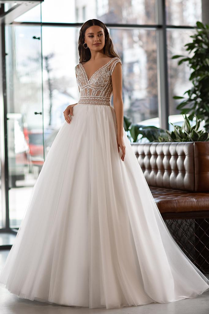 Wedding dress Joanna Silhouette  A Line  Color  Ivory  Neckline  Portrait (V-neck)  Sleeves  Sleeveless  Train  With train