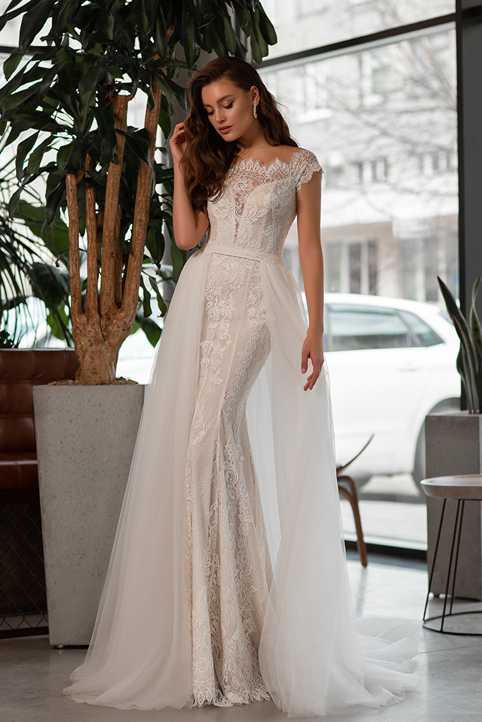 Wedding dress Laguna Silhouette  Fitted  Color  Ivory  Neckline  Bateau (Boat Neck)  Sleeves  Off the Shoulder Sleeves  Train  Detachable train