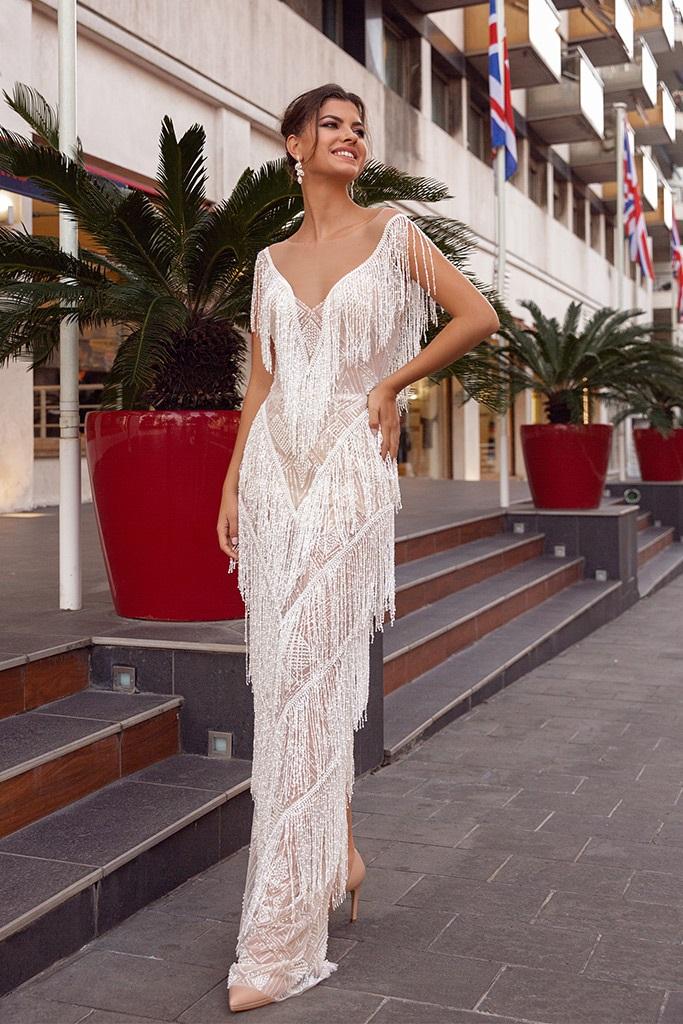Wedding dress Texas Silhouette  Sheath  Color  Ivory  Neckline  Sweetheart  Sleeves  Sleeveless  Train  No train