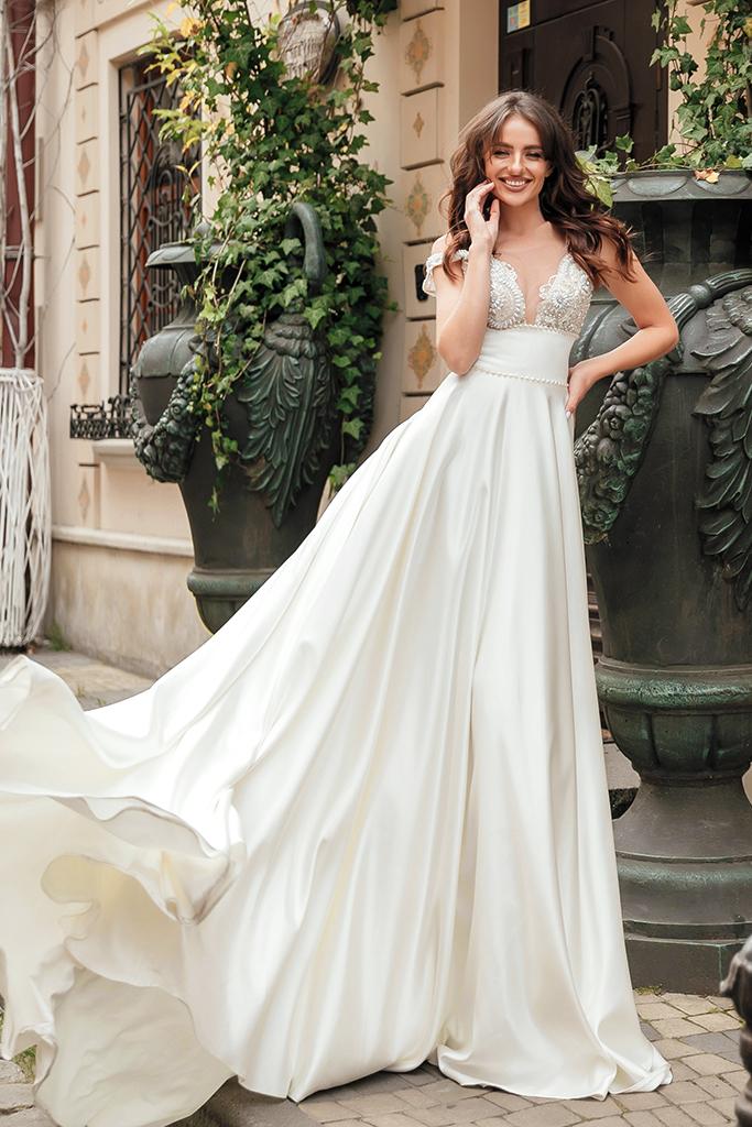 Wedding dress Bernadette Silhouette  A Line  Color  Ivory  Neckline  Portrait (V-neck)  Sleeves  Sleeveless  Train  With train