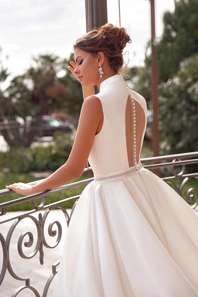 Wedding dress Kylie Silhouette  A Line  Color  Ivory  Neckline  Mandarin  Sleeves  Sleeveless  Train  With train