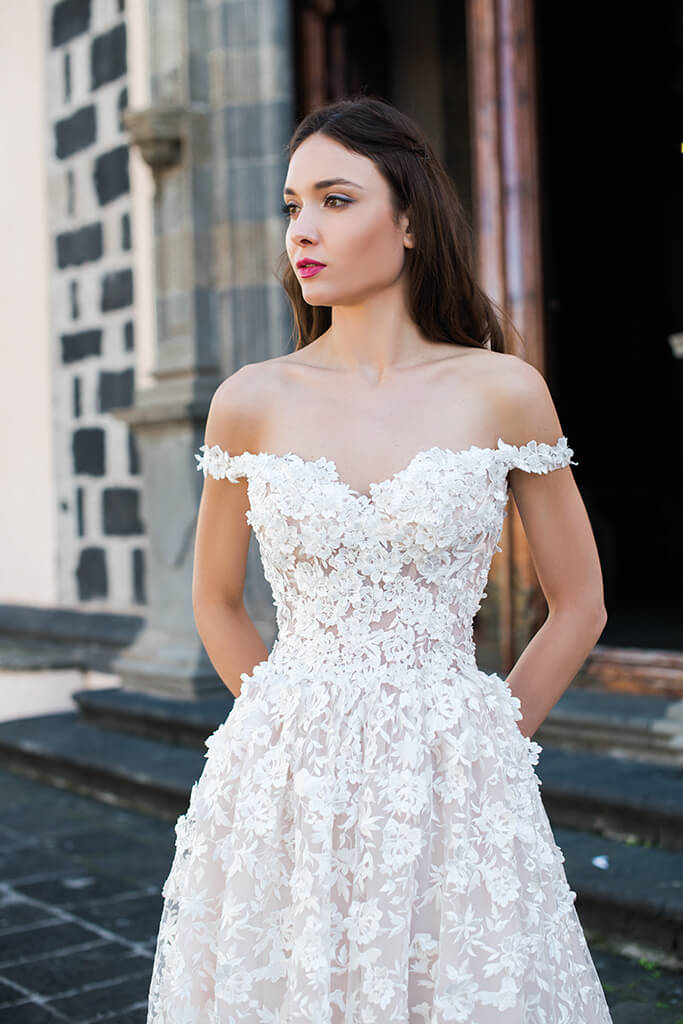 Wedding dresses Meadow Collection  Lisbon Lace  Silhouette  A Line  Color  Blush  Ivory  Neckline  Sweetheart  Sleeves  Off the Shoulder Sleeves  Train  With train