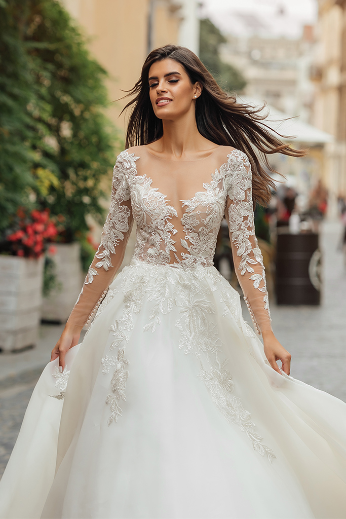 Wedding dresses Emma Collection  City Passion  Silhouette  A Line  Color  Blush  Ivory  Neckline  Portrait (V-neck)  Illusion  Sleeves  Long Sleeves  Fitted  Train  With train