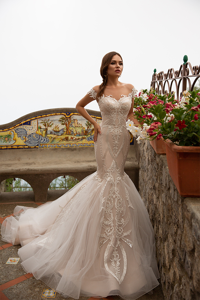 Wedding dresses Fidelia Collection  Dolce Italia  Silhouette  Mermaid  Color  Cappuccino  Ivory  Neckline  Sweetheart  Sleeves  Off the Shoulder Sleeves  Train  With train