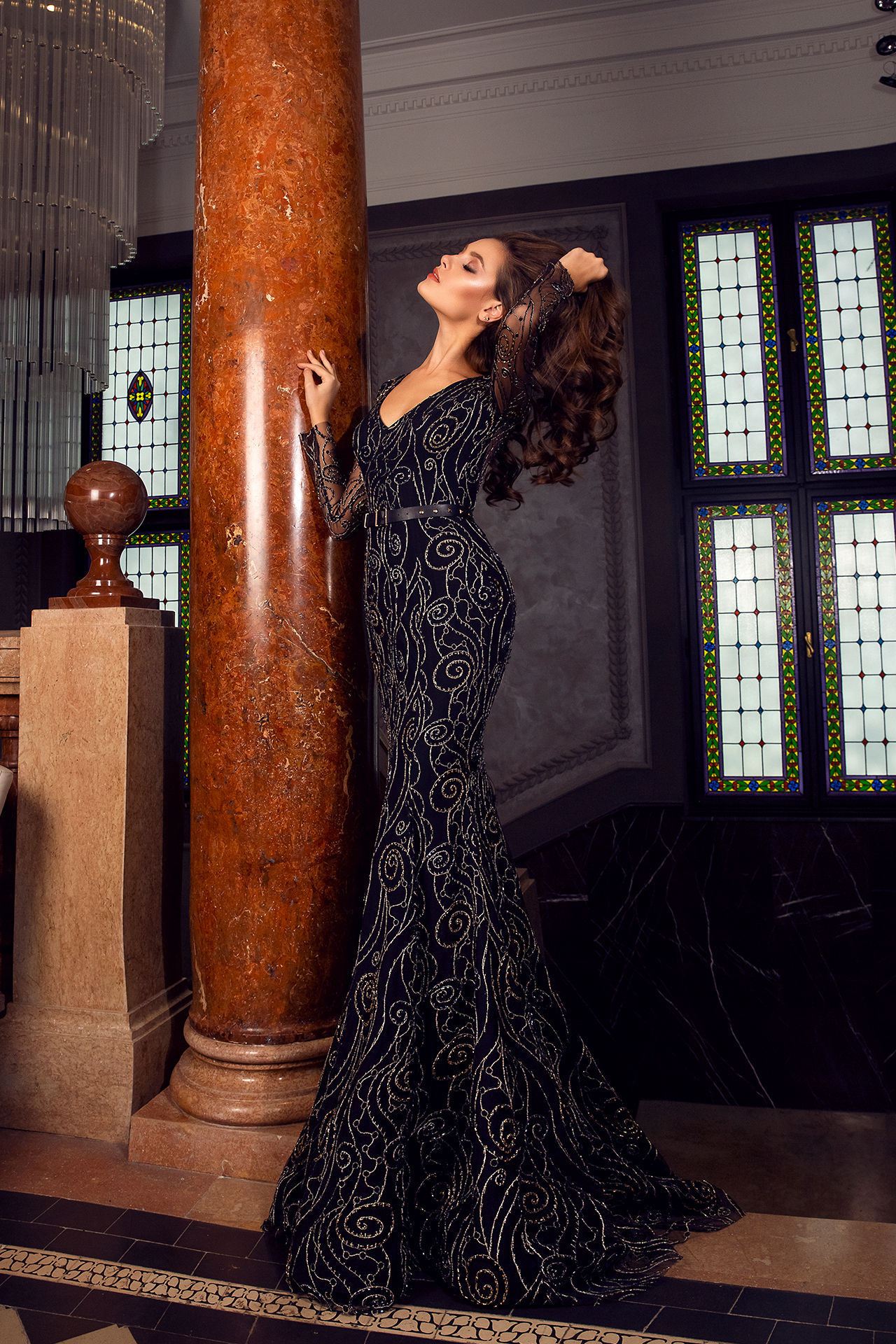Evening gowns S-1487 Silhouette  Fitted  Color  Black  Neckline  Portrait (V-neck)  Sleeves  Long Sleeves  Fitted