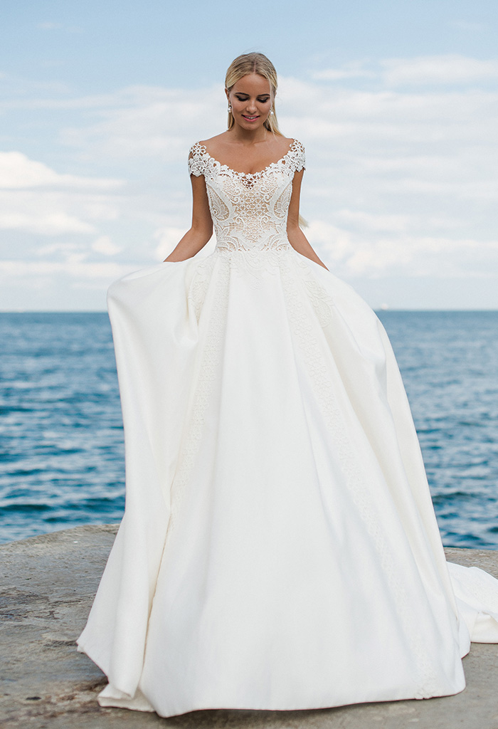 Wedding dresses Amina Collection  Voyage  Silhouette  A Line  Color  Ivory  Neckline  Sweetheart  Sleeves  T-Shirt  Off the Shoulder Sleeves  Train  With train
