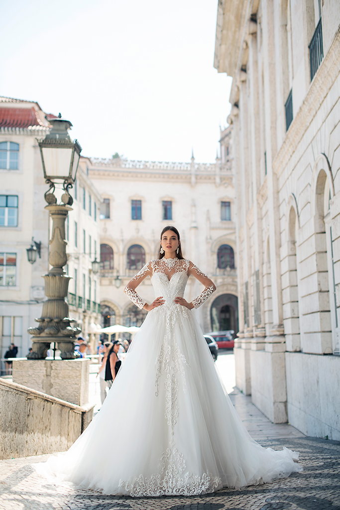 Wedding dresses Nikhan Collection  Lisbon Lace  Silhouette  A Line  Color  Ivory  Neckline  Sweetheart  Mandarin  Sleeves  Long Sleeves  Fitted  Train  With train