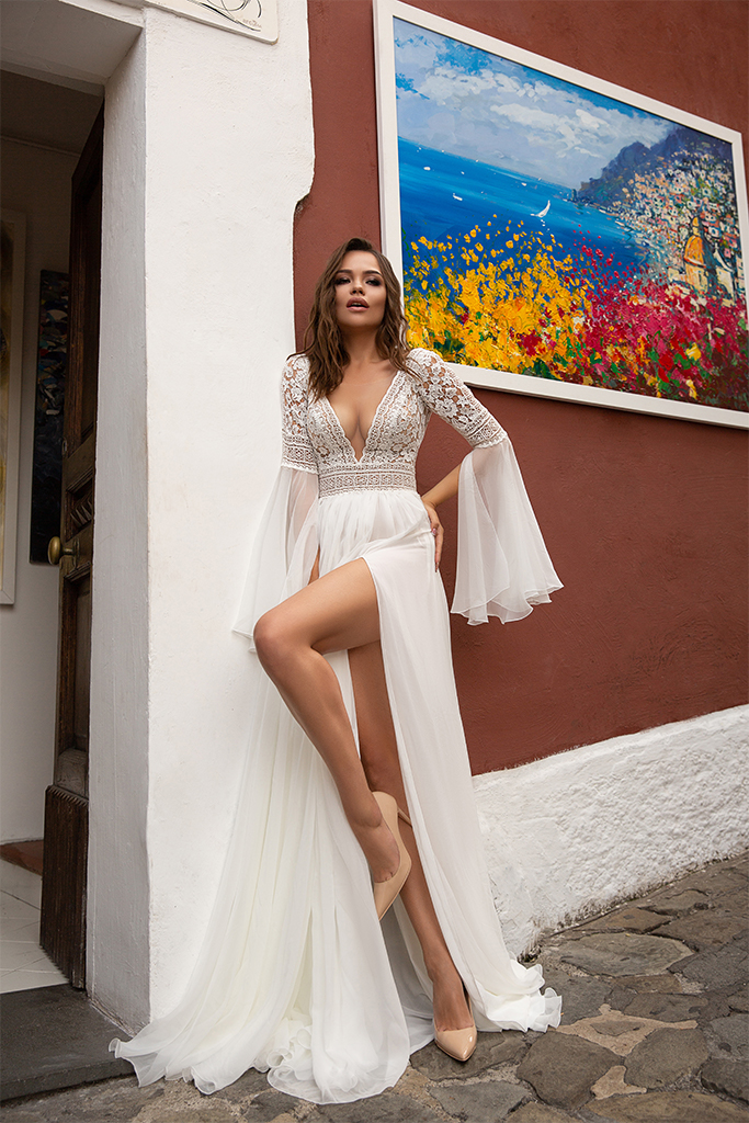 Wedding dresses Inge Collection  Dolce Italia  Silhouette  A Line  Color  Ivory  Neckline  Portrait (V-neck)  Sleeves  Long Sleeves  Bell  Train  No train