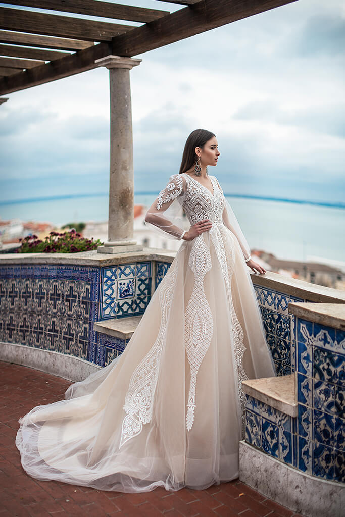 Wedding dresses Lexie Collection  Lisbon Lace  Silhouette  A Line  Color  Ivory  Neckline  Portrait (V-neck)  Sleeves  Long Sleeves  Balloon  Train  With train
