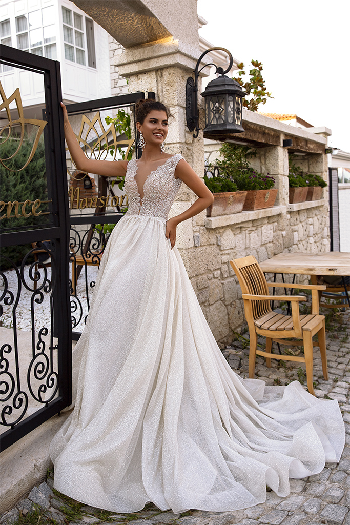 Wedding dresses Milly Collection  Highlighted Glamour  Silhouette  A Line  Color  Ivory  Neckline  Portrait (V-neck)  Sleeves  Wide straps  Train  With train