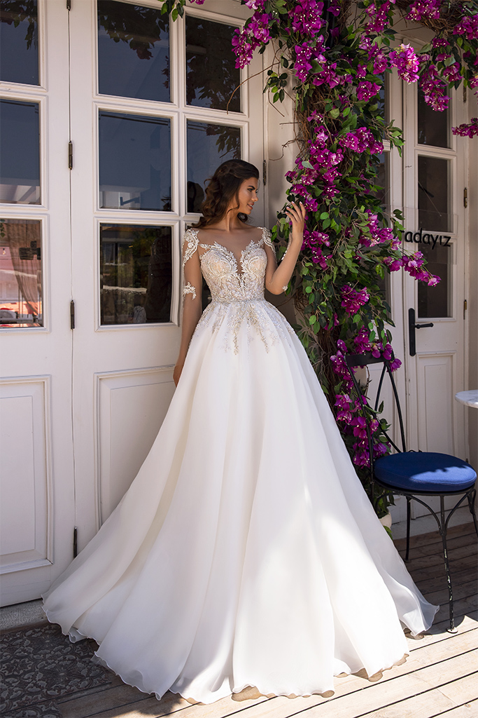 Wedding dresses MIRANDA Collection  Highlighted Glamour  Silhouette  A Line  Color  Cappuccino  Ivory  Neckline  Sweetheart  Sleeves  Long Sleeves  Fitted  Train  With train